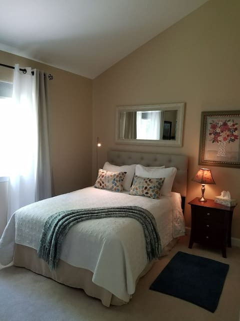 Sunny bedroom with private adjoining bathroom