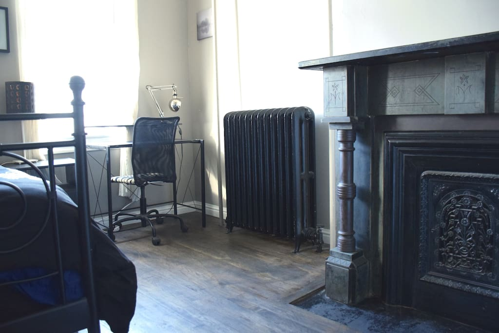 The desk and fireplace.
