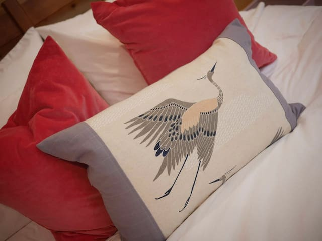 Down pillows, velvet accent cushions, Pacific Coast down duvet on Queen bed.