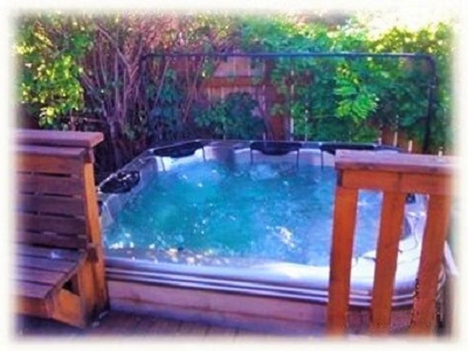 Large well-maintained hot tub is located in the private back yard