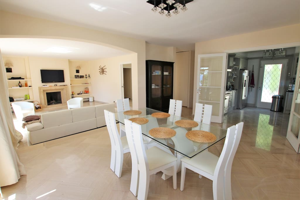 Large living room, dining area, all opening onto a terrace with sea view