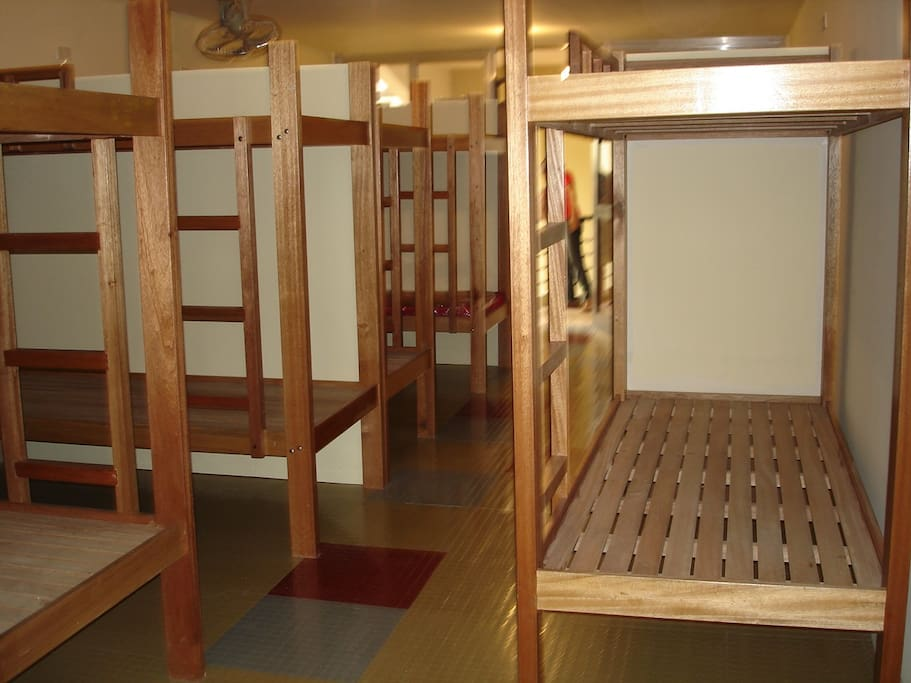 6 wooden double deck beds in the room