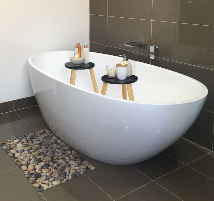 Main bathroom downstairs with large bath, toilet and oversized shower. There is also a Powder Room / Toilet to service the bedrooms downstairs. The Master bedroom is upstairs and boasts a full ensuite with spa bath and two walk in wardrobes.