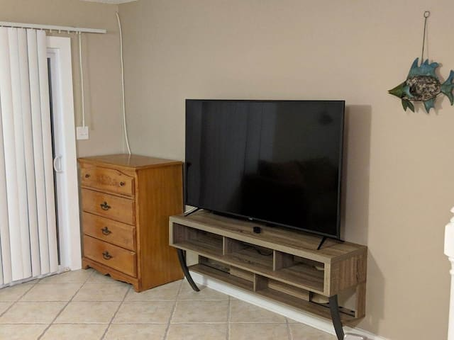 Large living room smart TV with outdoor patio access for your entertainment needs!
