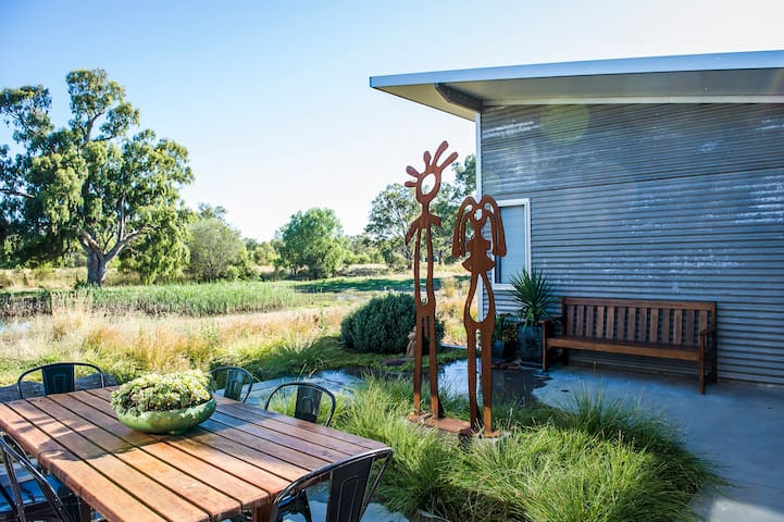 Your private deck at Girragirra has a barbecue and outdoor setting.