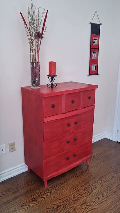 This dresser has just been redone in red and black