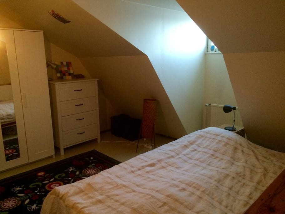 Bedroom. Lovely light from the roof window. Comfortable double bed. Also good, ergonomic working unit with table&chair.