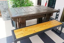 Custom made outdoor table and bench for guests. Guests can sit and relax enjoying the nature ^^