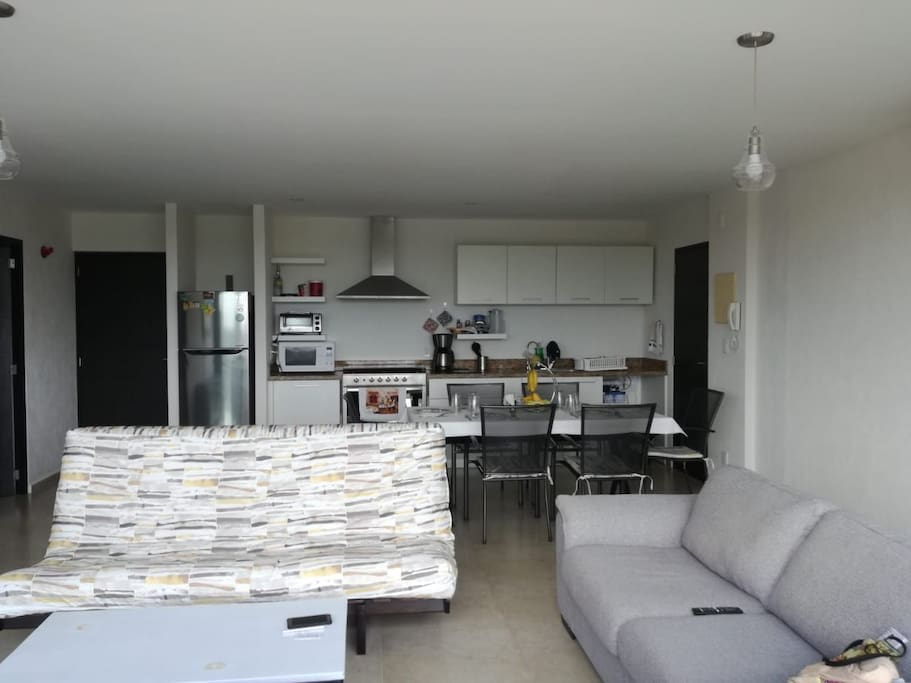 Kitchen, dining area, and living room