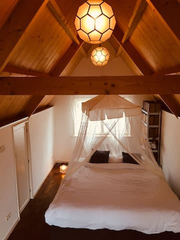 Wooden roof, bed has luxurious mosquito net