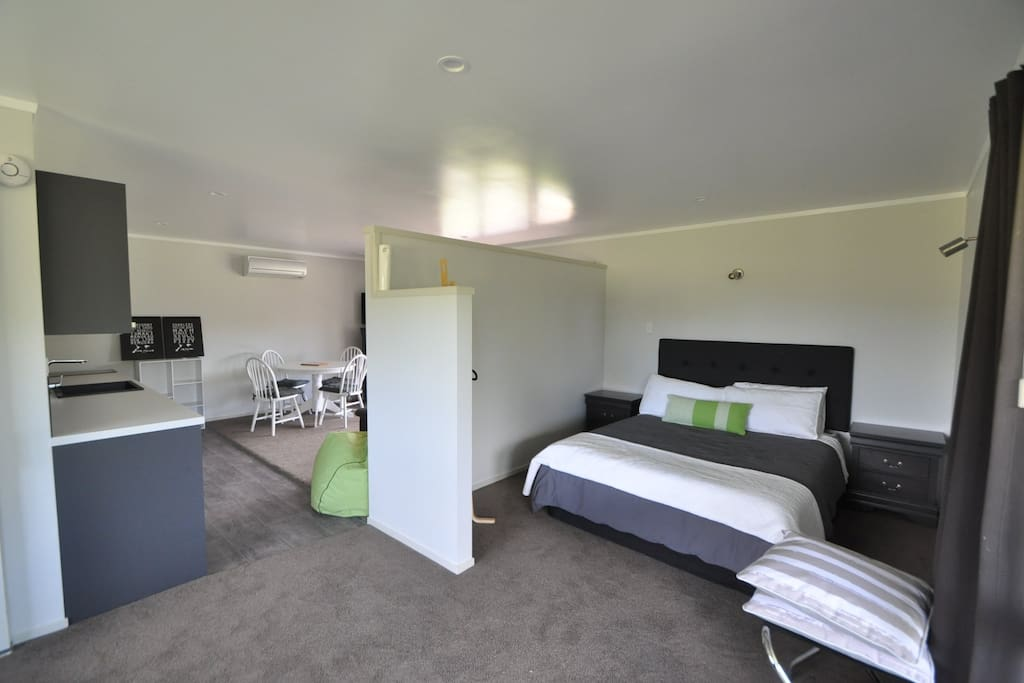 Our studio unit with a privacy wall for the Queen bed