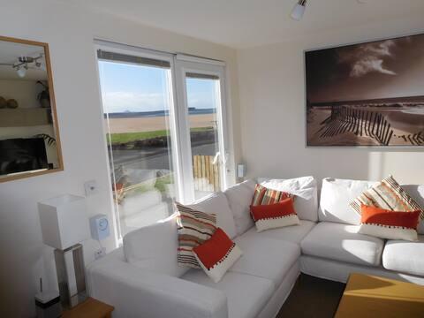 Luxury beachfront chalet with stunning sea views