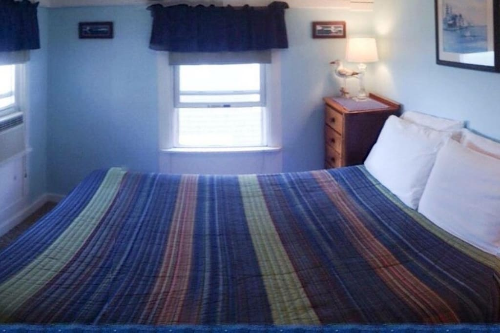 The Lighthouse Room has one Queen sized bed and private bathroom; decorated with shore scenes and lighthouses