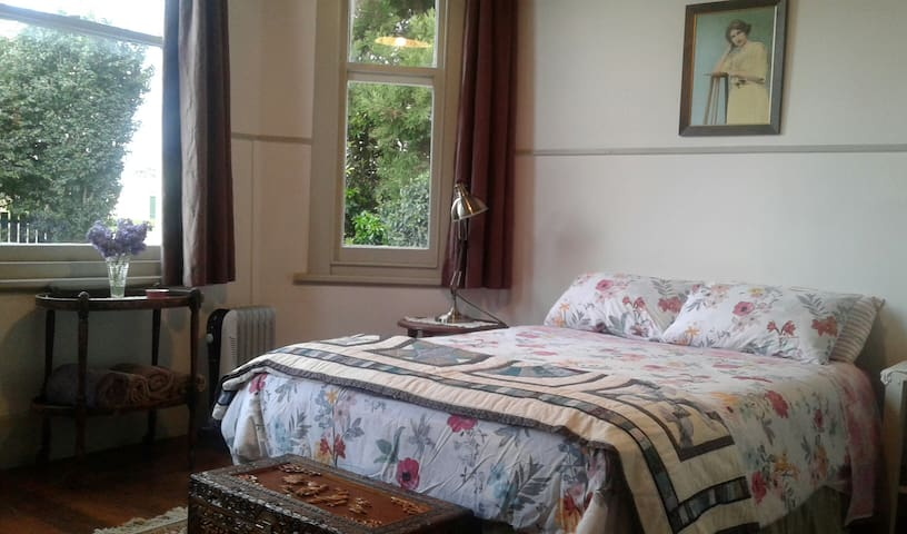 Double room with very comfy double bed. Look out the windows into the garden.
