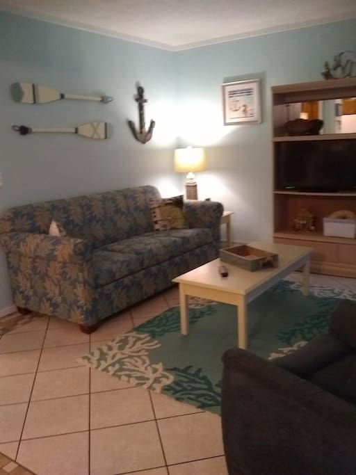 Living room has queen sofabed, recliner and a large TV --- very comfortable