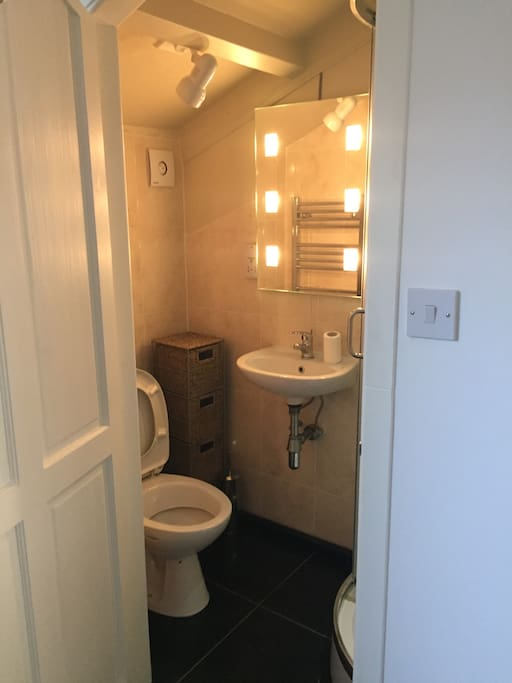 Ensuite shower room with illuminated vanity mirror