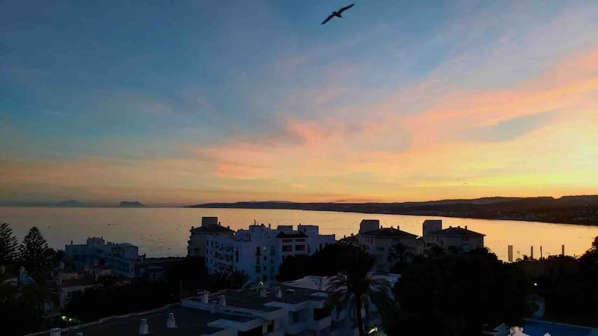 Crystal clear sunset with view of Jebel Musa in Morocco and the rock of Gibraltar.