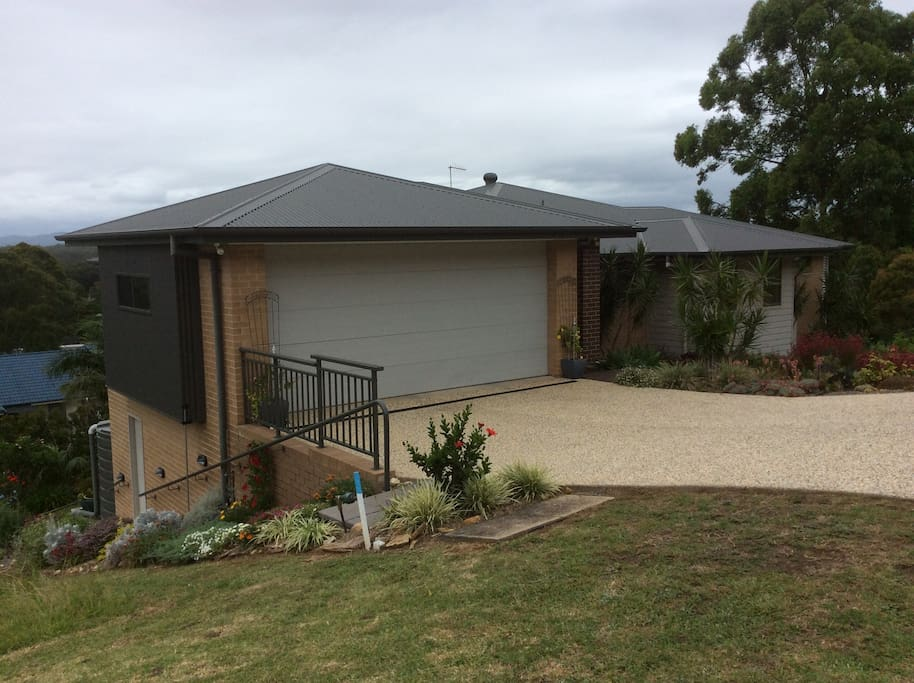 Front of house and showing walkway at side of house leading to private entrance.