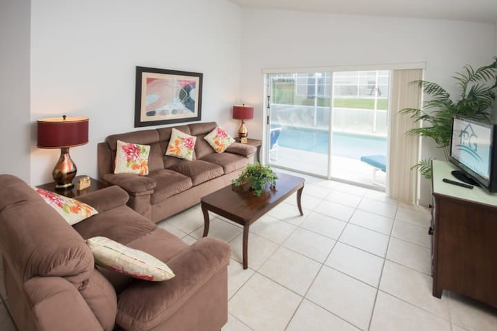 The Living Room,With Patio Doors to the Pool & Flat Screen TV