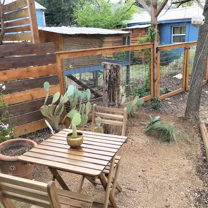 a small bistro table to enjoy your morning coffee - note your backyard neighbors are chickens :)