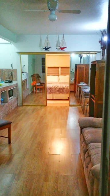 Spacious , clean and neat open living room and kitchen.