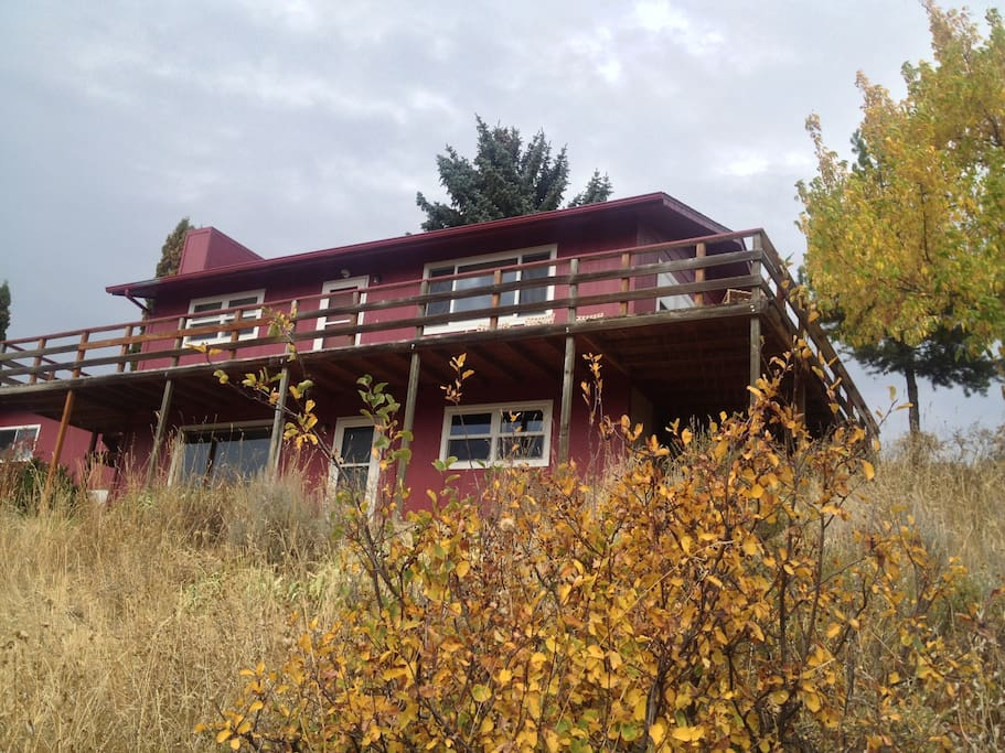 The home is located on a beautiful south facing hillside at the mouth of Fox Creek Canyon.
