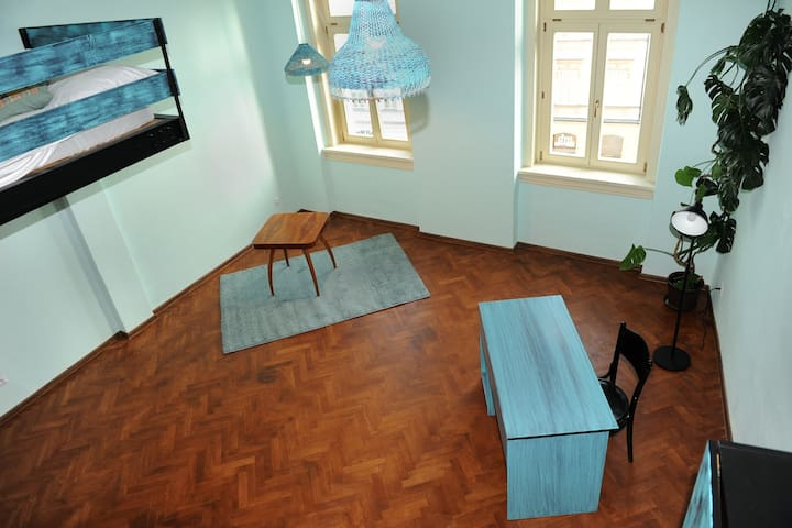 Wooden room in a theatre apartment in the center