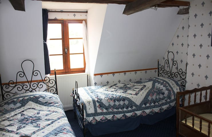 Bedroom with 2 single beds, and toddler bed. Baby crib is also available. Lovely courtyard view