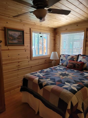 Second bedroom with full size bed. Lockable door for privacy and 1/2 bathroom.