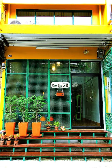 Hostel Exterior - Yellow building & Green gate // 100 meters from the main road.