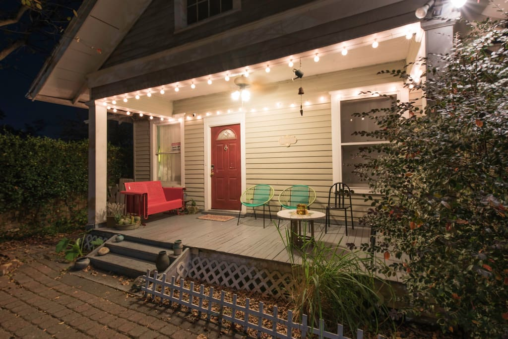 Hang out on the porch with seating for 7. Includes a retro glider, CB2 lounge chairs and metal Italian chairs. -- Don't forget to turn on the lights!