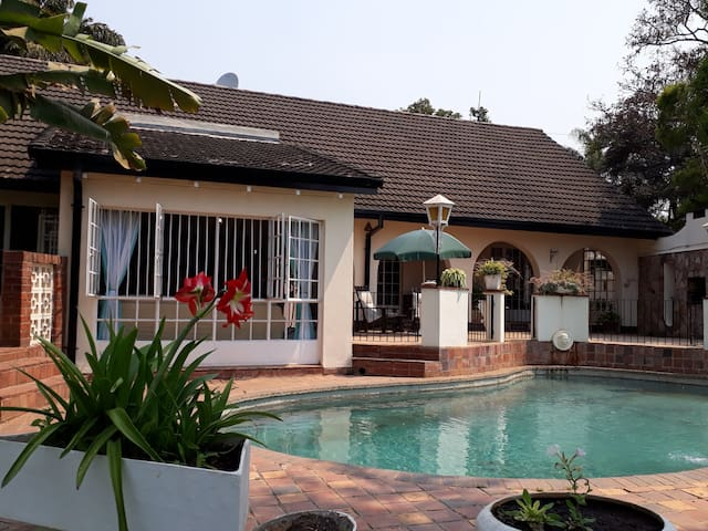 Doors from the kitchen, dinning room and pool lounge lead onto the pool patio.