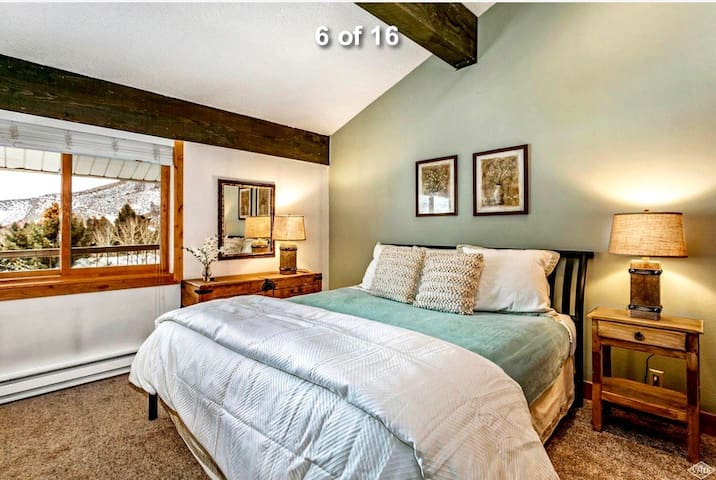 Lovely and spacious green room with gorgeous mountain and lake view!  TV in the room along with private bathroom, drawers and large closet.  BRAND NEW KING BED!!!