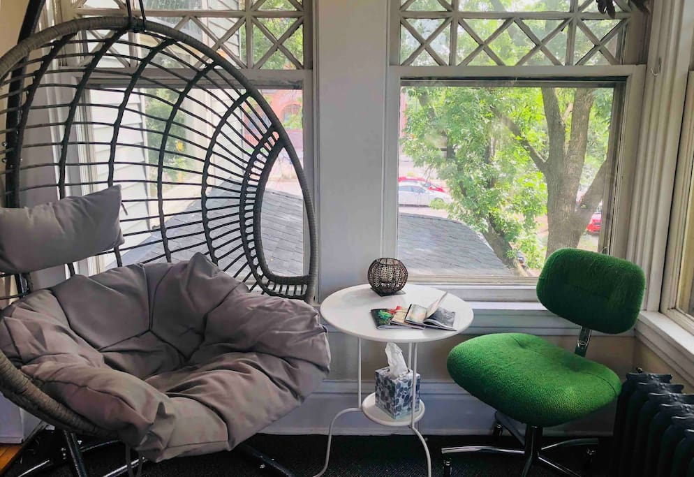 Bright sunroom for reading, art, relaxing, and hanging out with the kitties