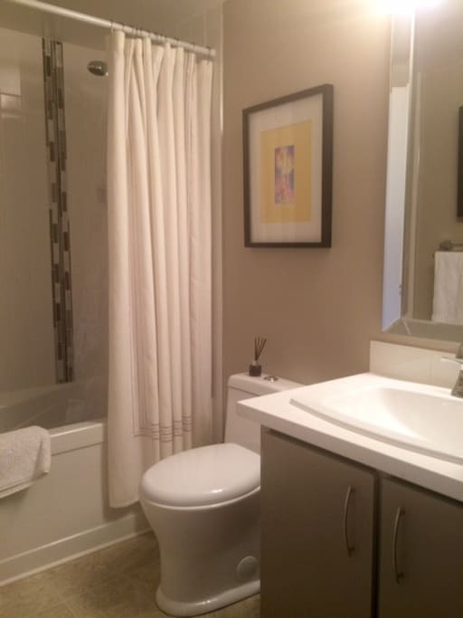 new bathroom with soaker tub, high quality linens and original art