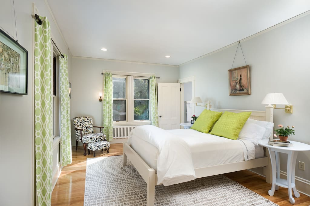 The master bedroom has four large windows with southern and eastern exposure spilling natural light into the room.  Comfortable new queen mattress and fine linens.
