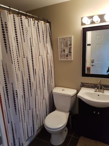 Full bathroom and tub/shower beautifully updated