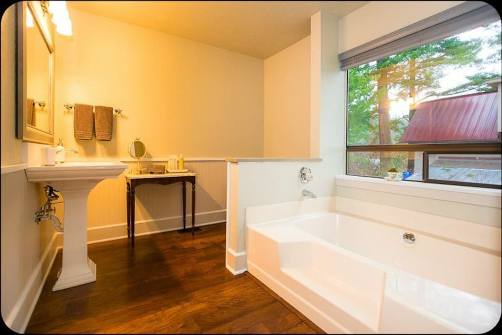En-suite bathroom with soaking tub and standing shower