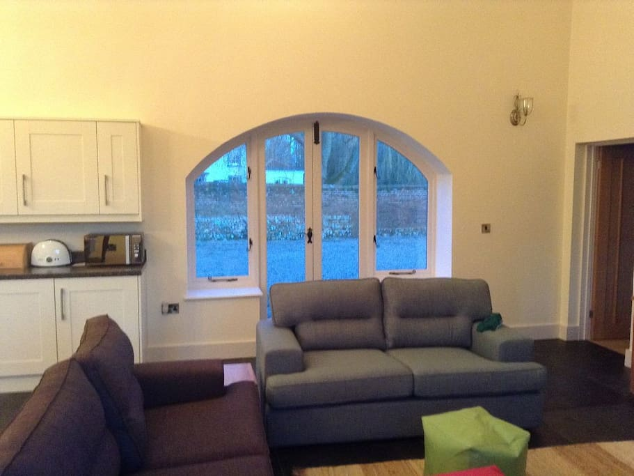 Seating area with 3 sofas and TV