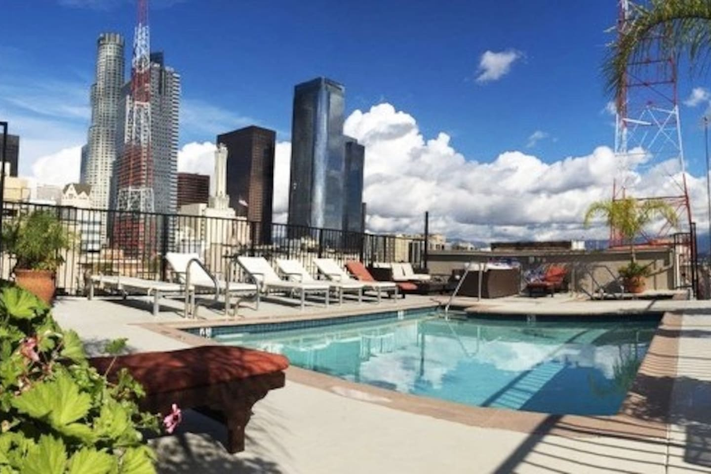 Rooftop pool and jacuzzi with skyline view