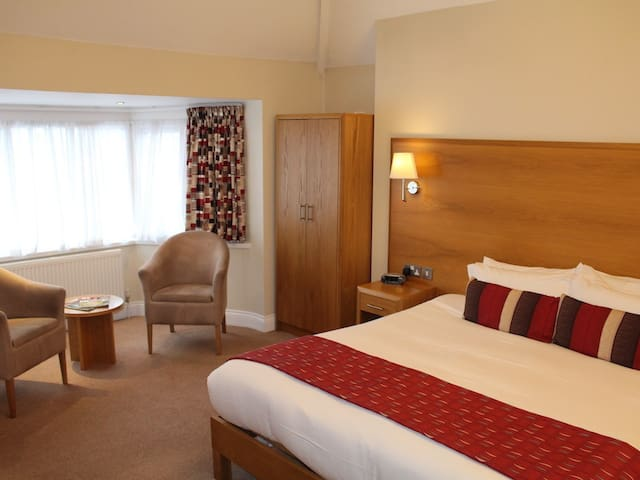 Huge ensuite double in clothing optional spa hotel