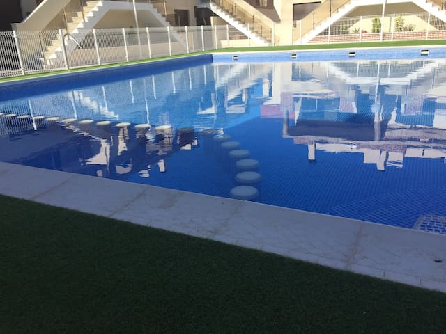 Communal pool right outside the back door with child safe area