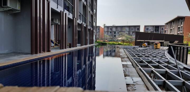 A modern pool villa studio in Replay condominium