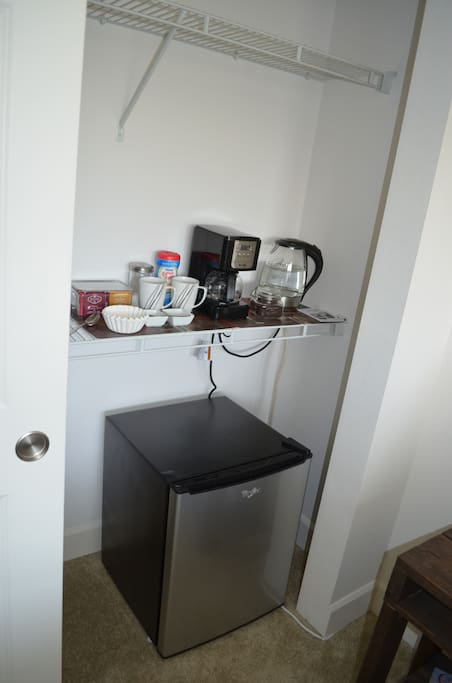Bedroom 1: There is also a fridge in the room with a coffee and tea bar!