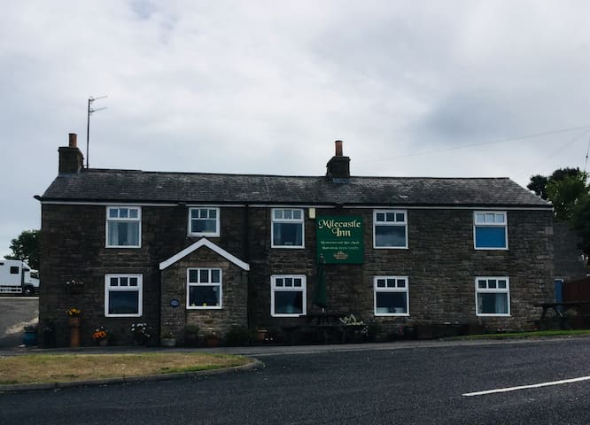 Traditional pub/restaurant next to cottages