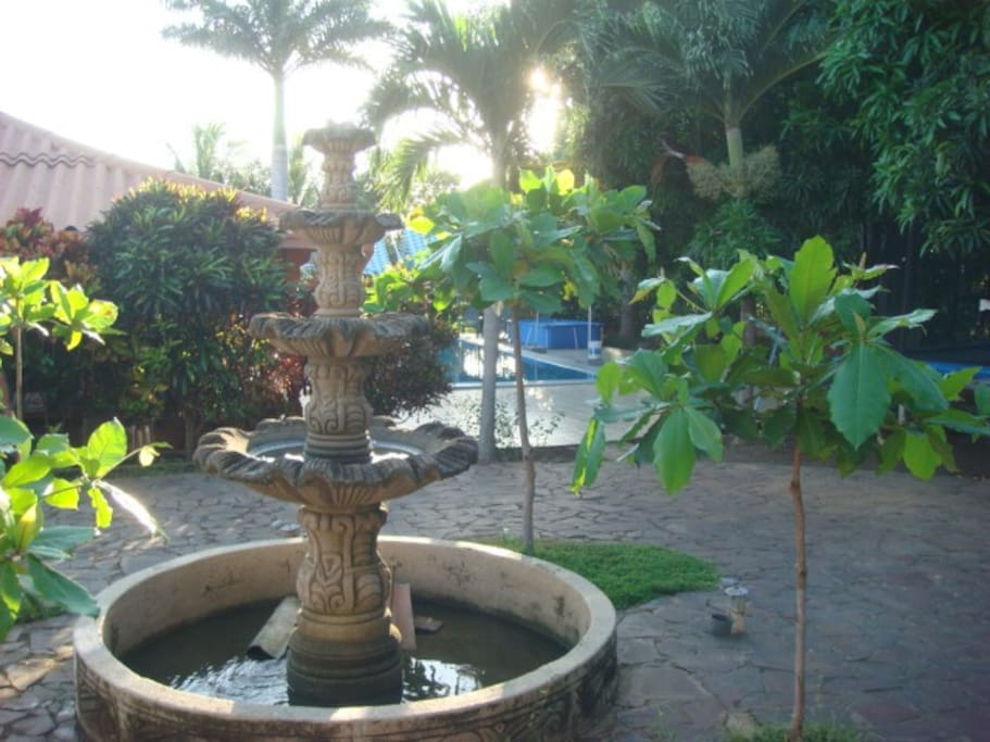 """5 tiered """"turtle fountain"""" by the pool"""