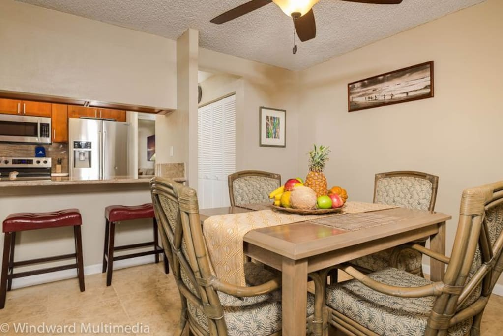 Dining table good for 4 guests with extra seating at the counter.