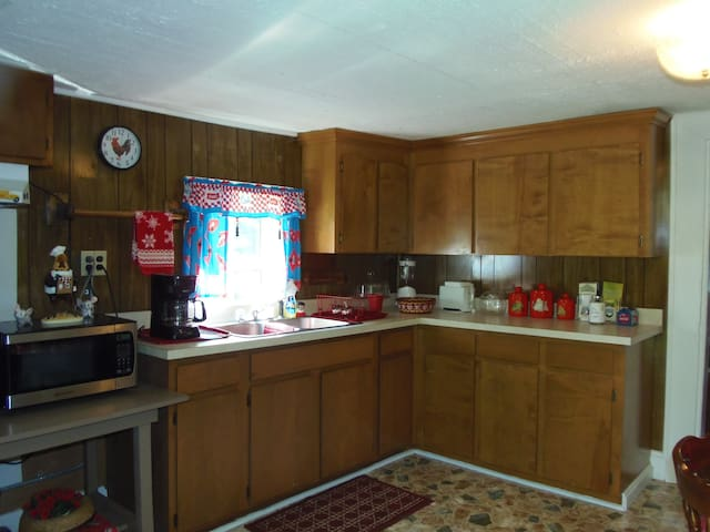 """""""Ma's Kitchen"""" comes equipped with a small refrigerator, microwave, and coffeemaker."""