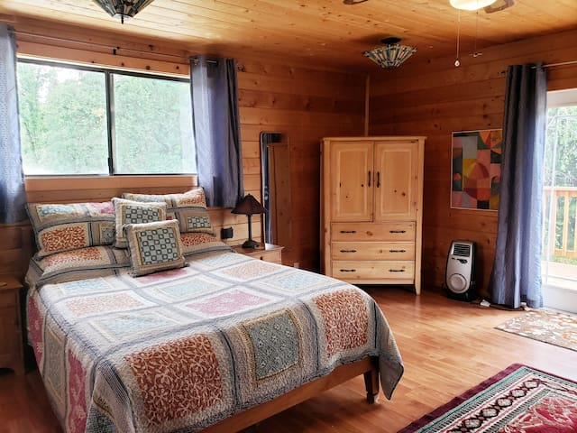 Enjoy the queen bed and armoire for your clothing.