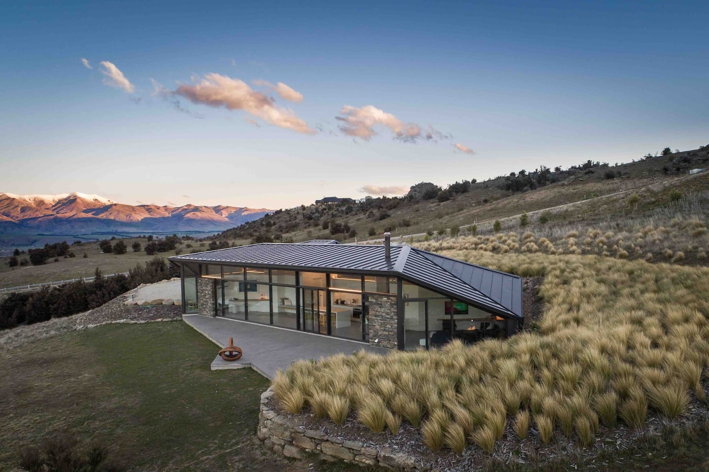The Hawk House - Rangi Kahu (Sky of Hawks) in Maori - has just won four Master Builder awards, including the Supreme House of the Year 2019 for the Southern region. Its design mimics hawk wings and the mountain folds across the beautiful valley.